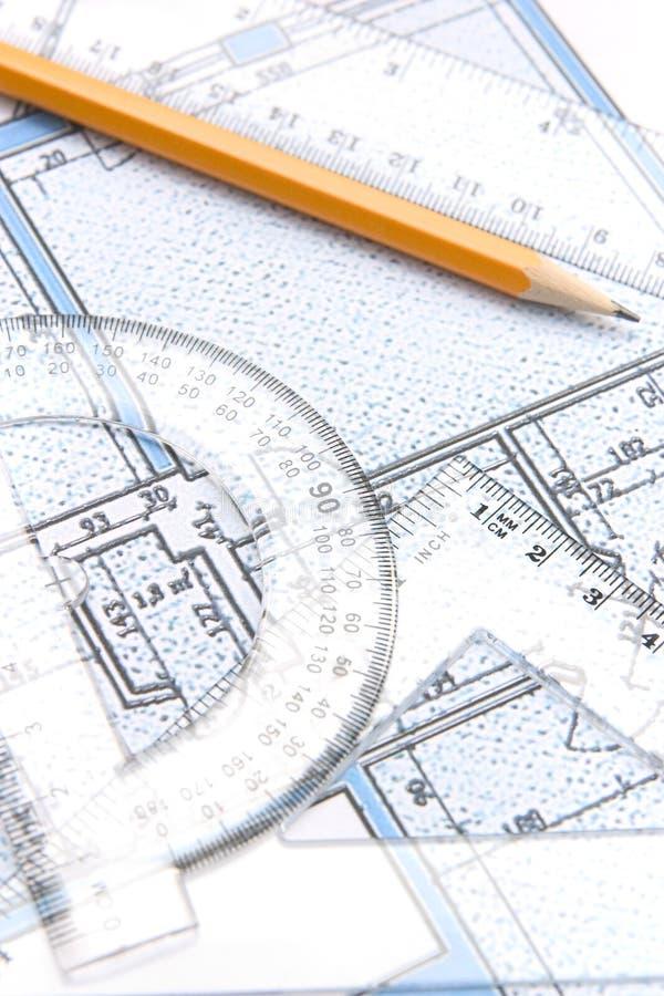 Outils géométriques et un plan d'étage photos libres de droits