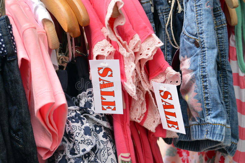 Outlet. Kids Fashion labelled by a sale sign stock photos