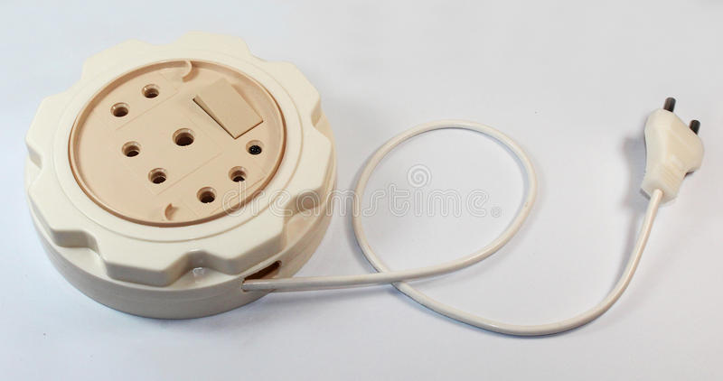 Outlet with Plug. An outlet junction box with plug close up photo royalty free stock image