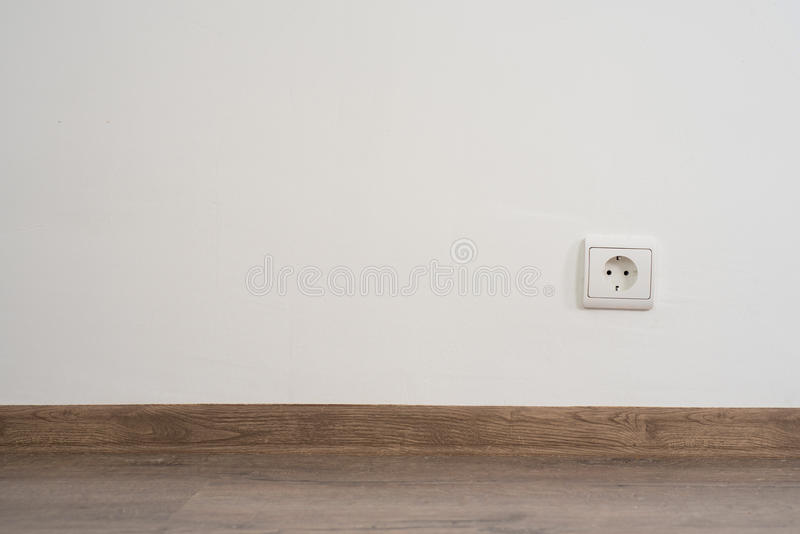 Outlet on wall. Electrical outlet on white wall. home design stock photo