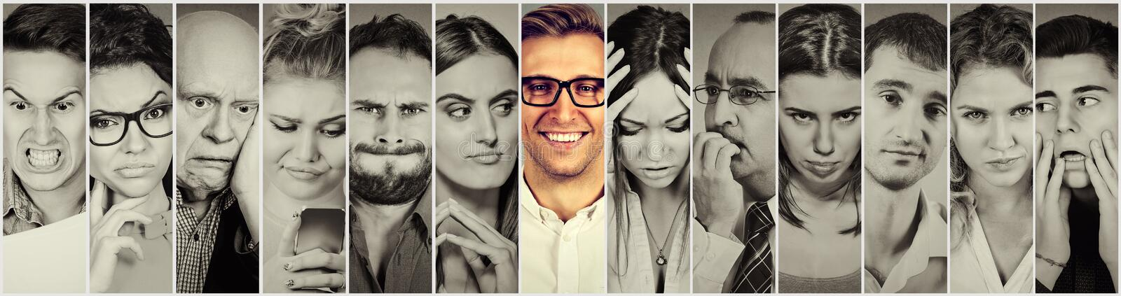Outlier. Group of negative people and happy man stock image