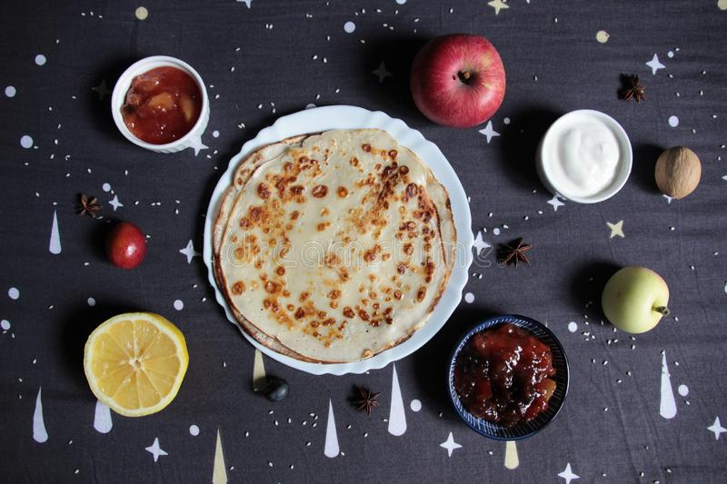 Outline of the universe with pancake as Sun and planets as fruits and toppings stock photography
