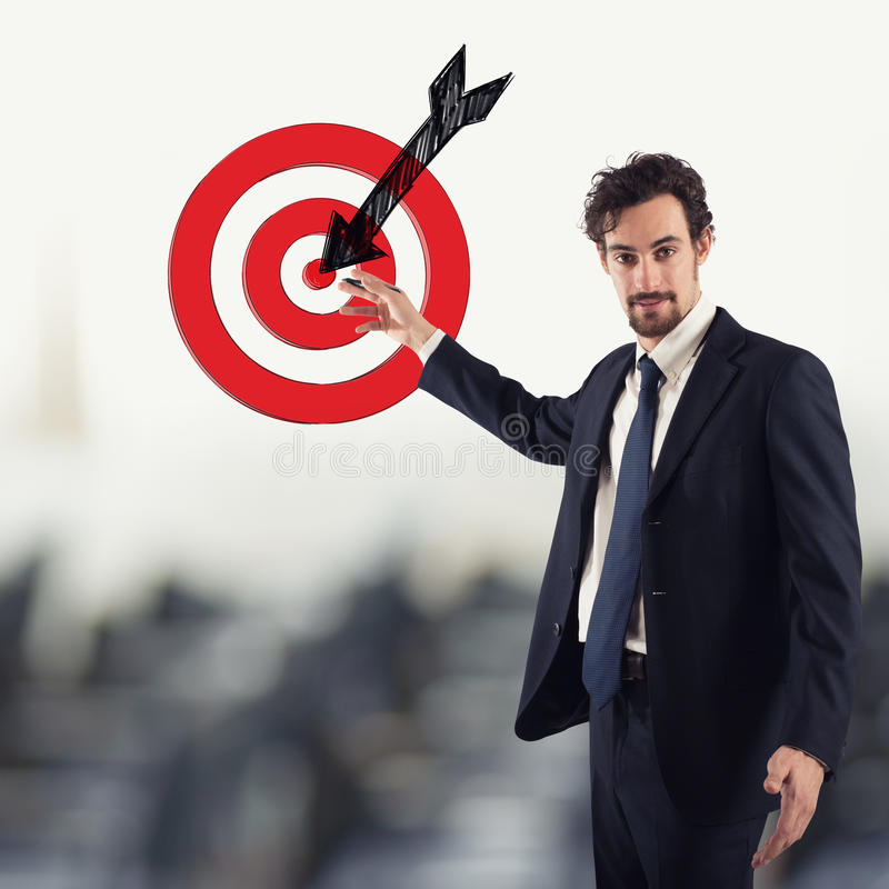 Outline your goals. Businessman drawing a target with the arrow. Outline your goals concept stock photo
