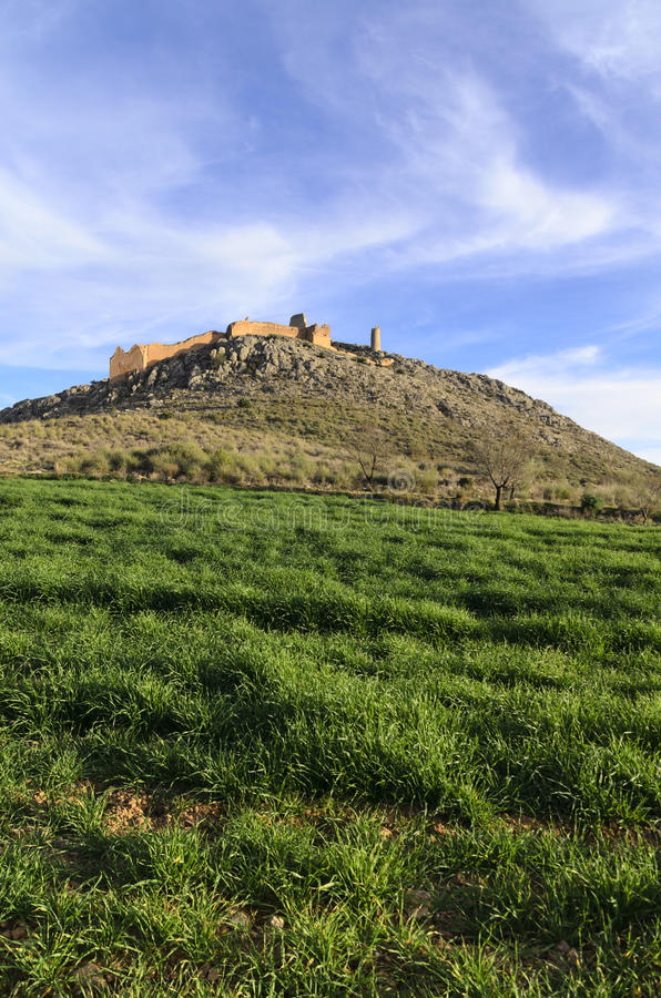 Outlined on a hilltop are the ruins of the Castle of Xiquena