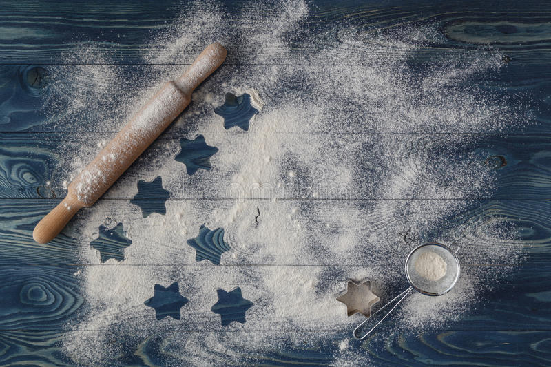 The outlines of Christmas stars on the scattered flour. Bright b royalty free stock photo