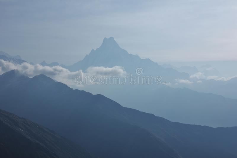 Outlines of famous Mount Fishtail, Machapuchare. stock photos