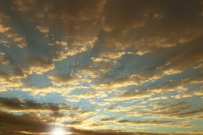 Outlines of the village and the natural landscape against the backdrop of a bright sunrise. Morning romantic mood. Natural phenome. Non in the atmosphere. The stock photo