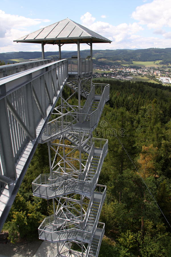 Outlook tower with bridge. Modern steel outlook tower with bridge stock image