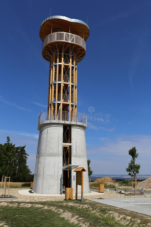 Outlook tower. Modern wooden outlook tower with concrete base royalty free stock image