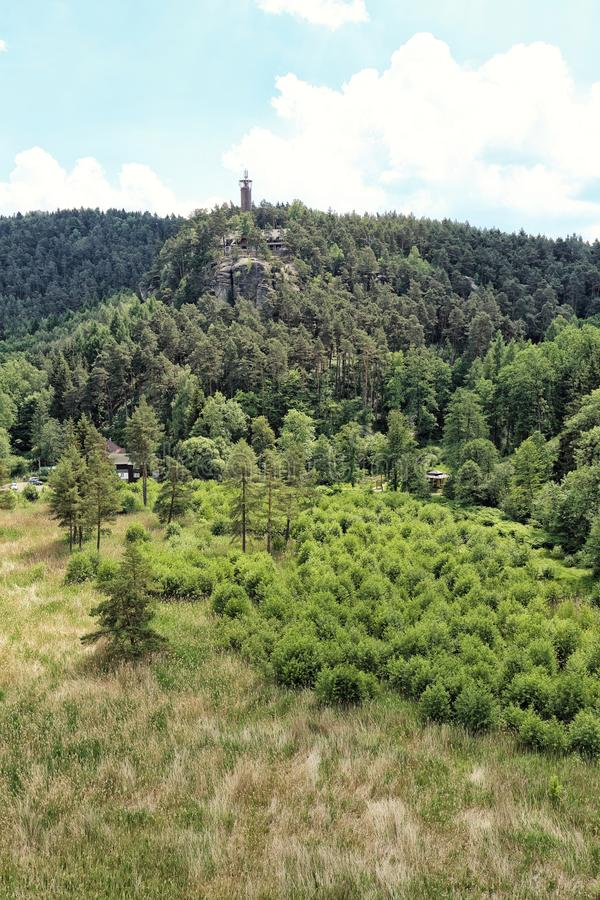 Outlook tower on the rock above the forest. S in Bohemia royalty free stock photo