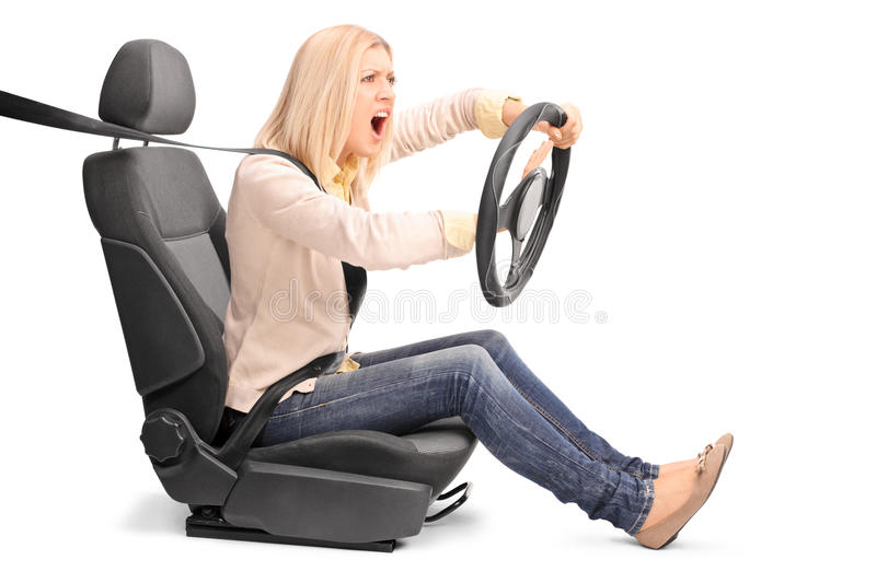 Outraged woman driving and honking. An outraged young woman pretending to drive and honking the horn isolated on white background stock images