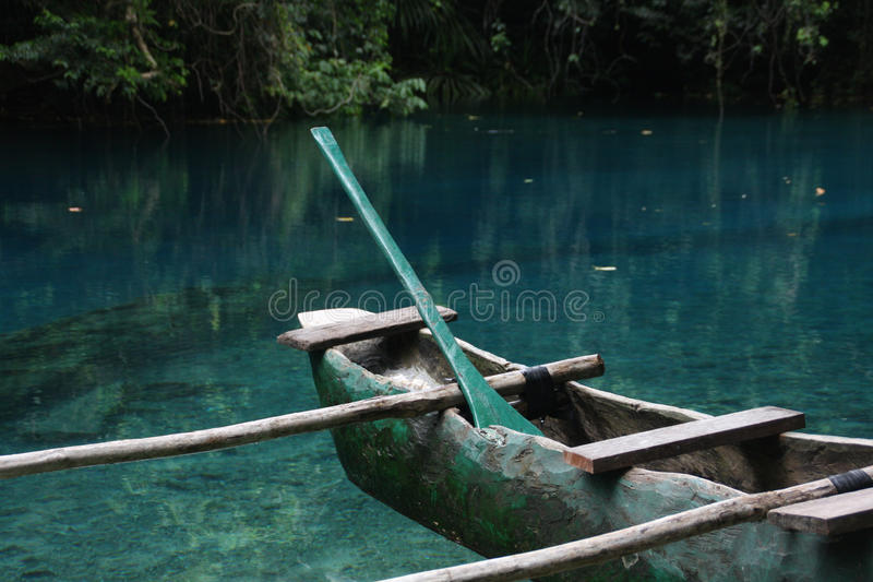 Outrigger canoe. In crystal clear water of the Blue Hole, Vanuatu, an Oceanian island nation located in the South Pacific Ocean stock images