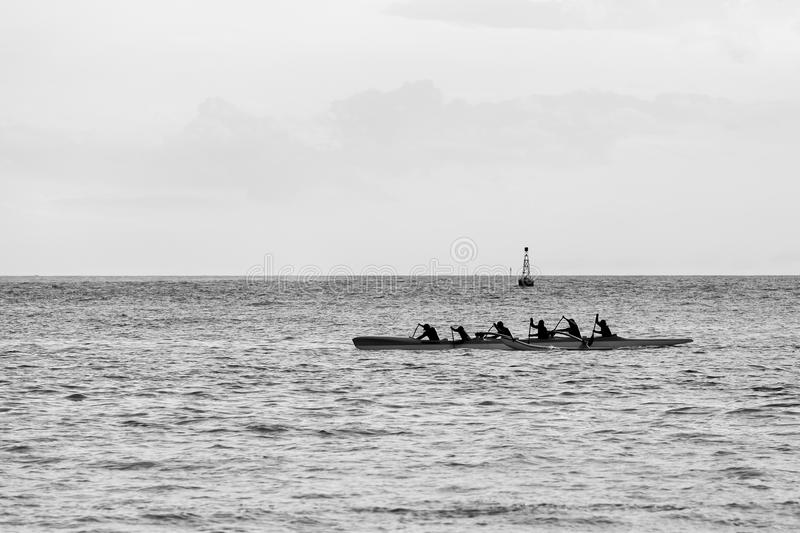 Outrigger Canoe. Six paddlers in a outrigger canoe stock images
