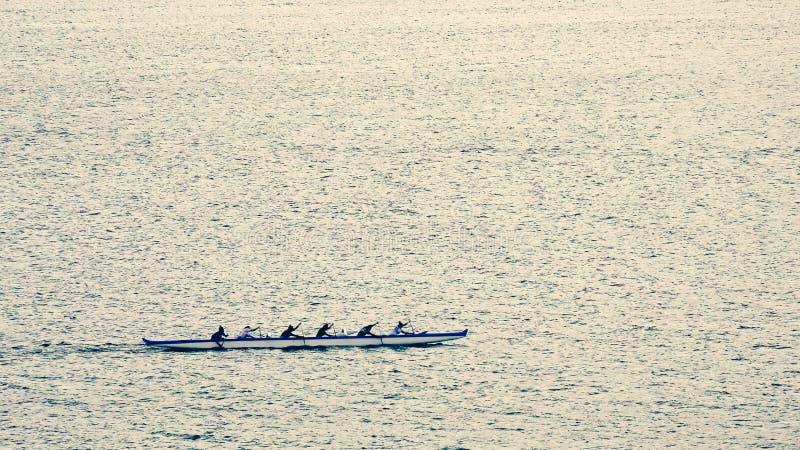 Outrigger Canoe Team Rowing near Lahaina, Hawaii stock photo