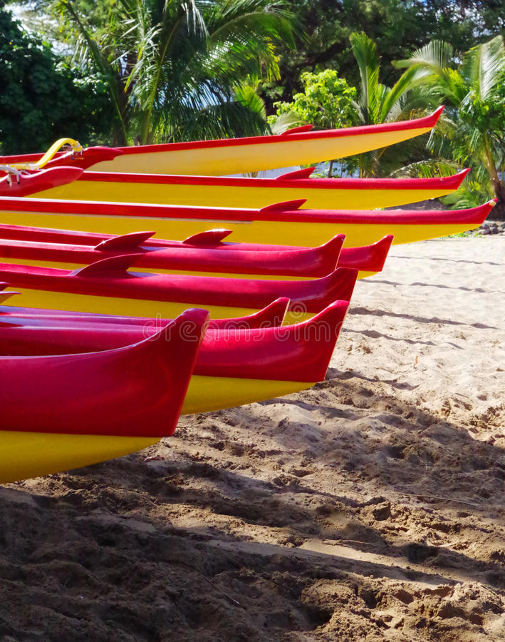 Outrigger canoes on the beach in Maui, Hawaii royalty free stock photography