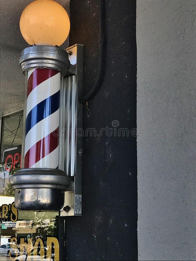 Barber`s pole. Outside a barber shop near the entrance royalty free stock images