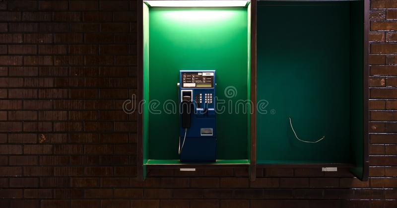 Outside phones at night. Outside blue phones at night stock image