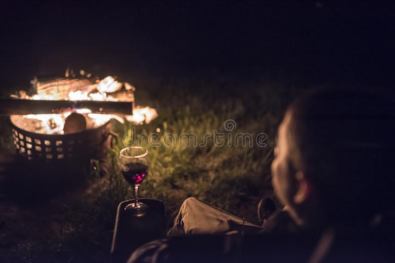 A man looks at an outside fire royalty free stock photography