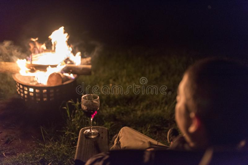 A man looks at an outside fire in a container stock photos
