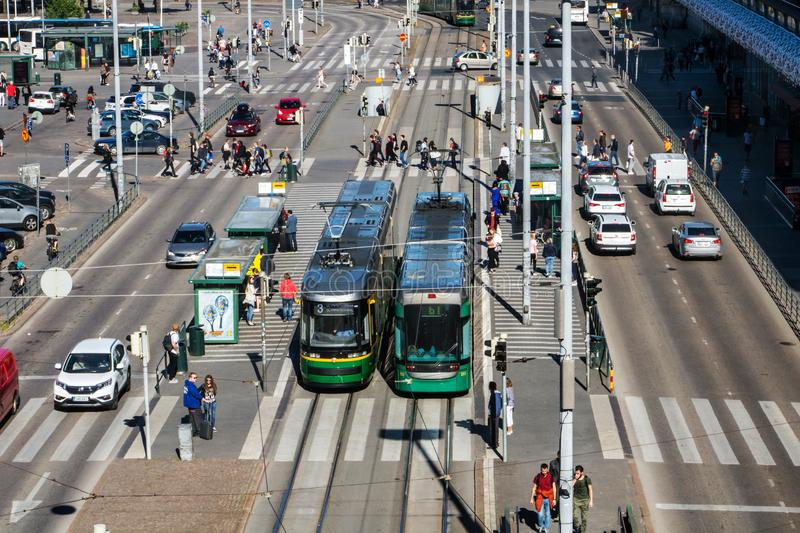 Outside the Helsinki Central Railway Station. FINLAND, HELSINKI, JUL 02 2017, trams are standing on the main street beside main railway station at Helsinki royalty free stock image