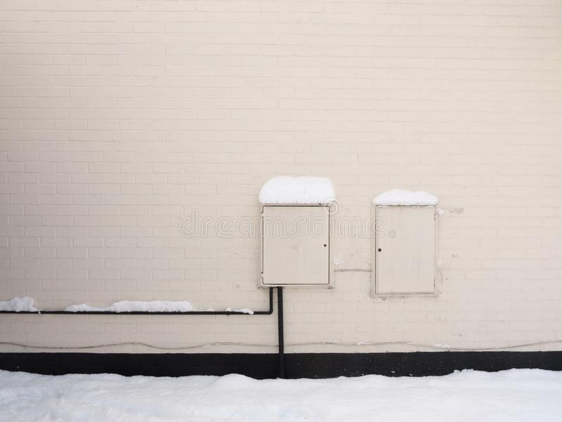 Outside of house with electrical and gas white box points uk pow stock image