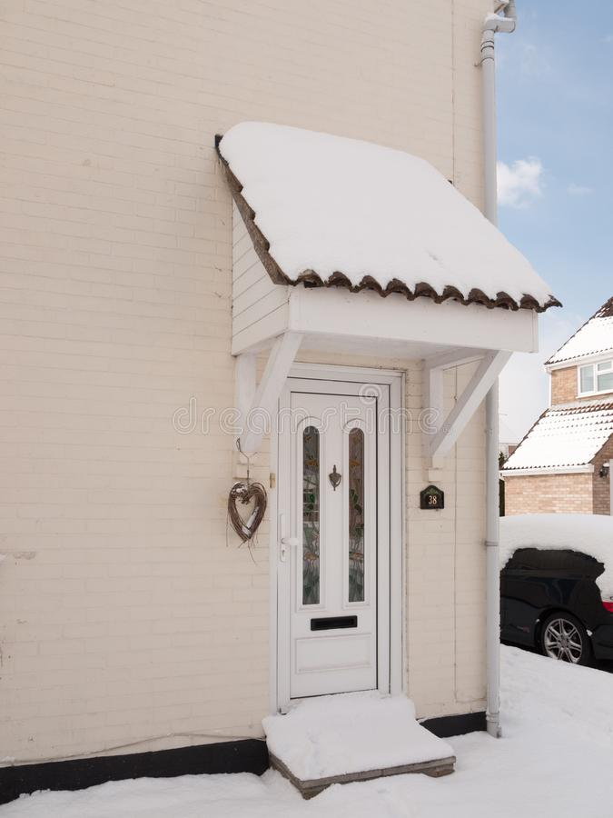 Outside of house with snow on front porch covered. Essex; england; uk royalty free stock image
