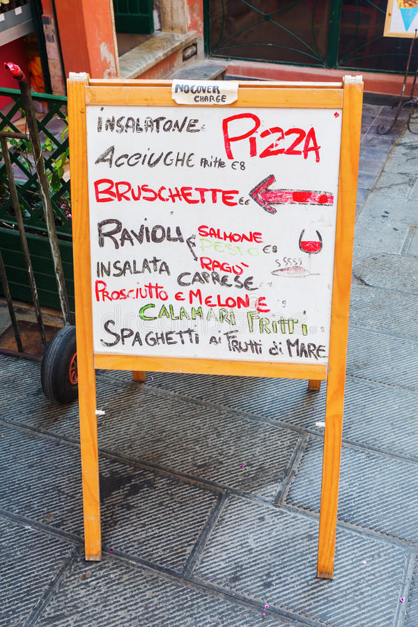 Outside menue board of an Italian restaurant royalty free stock image