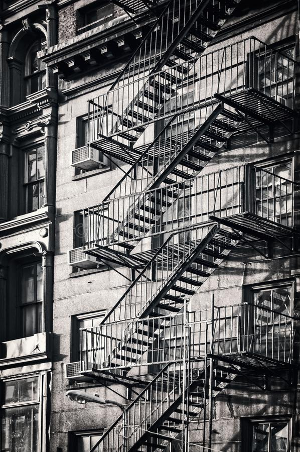 Outside metal fire escape stairs, New York City black and white. Outside metal fire escape stairs, New York City, black and white royalty free stock photos