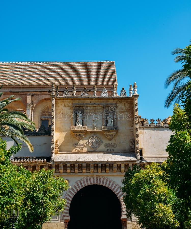 Outside the Mezquita of Cordoba from the Patio de los Naranjos - UNESCO World Heritage Site. Cordoba, Spain - July 13, 2018: Outside the Mezquita of Cordoba from stock photography