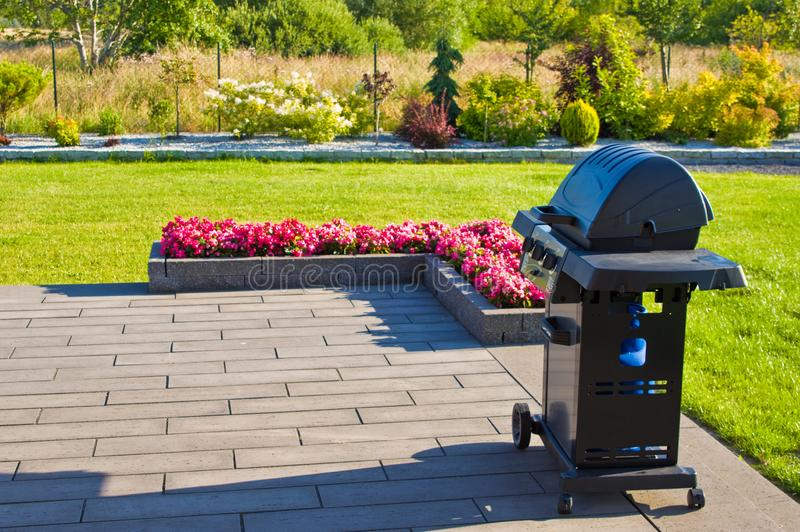Home terrace with gas barbecue abstract stock photo
