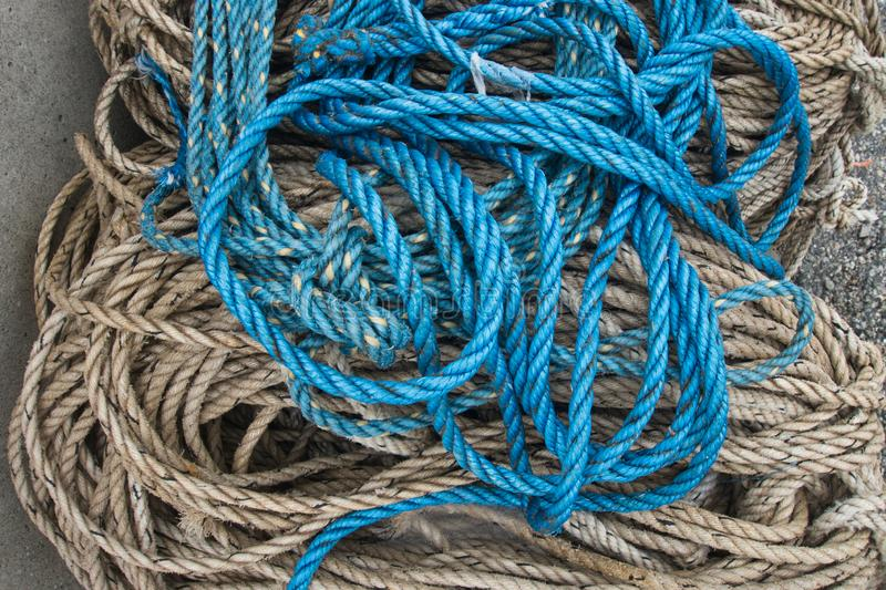 Outside nature photo featuring blue rope texture from a lobster boat royalty free stock photos