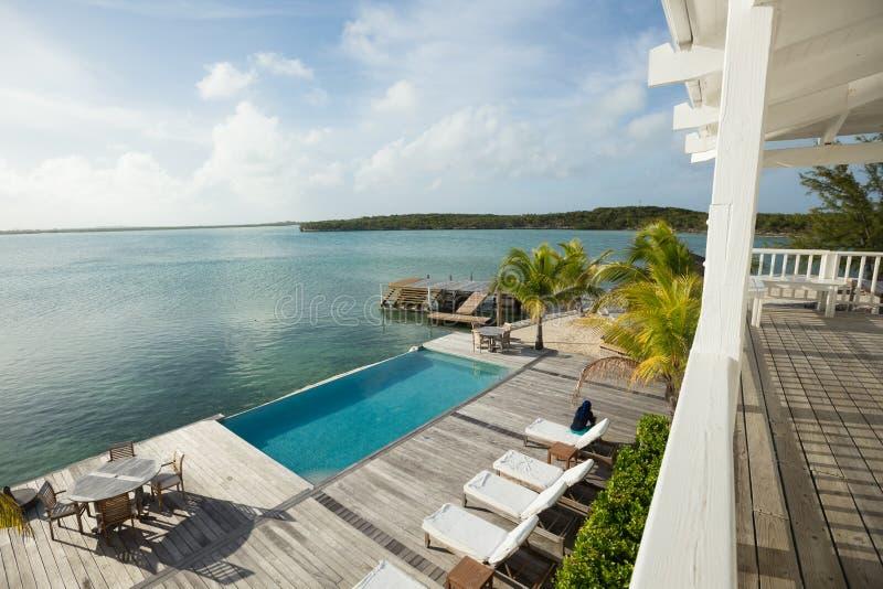 Waterside pool, Exuma, Bahamas. Outside of resort with waterside pool in Exuma, Bahamas on sunny day royalty free stock image