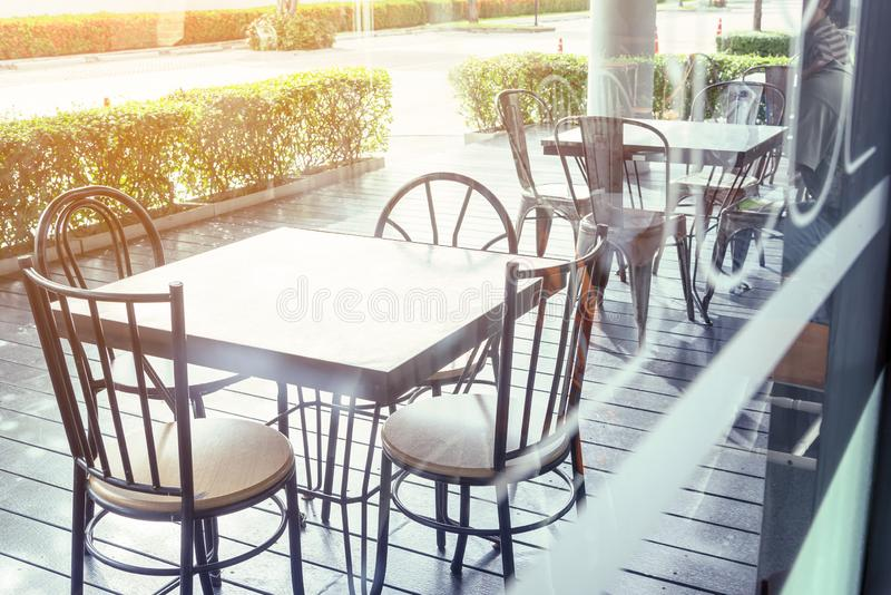 Outside shop in sunny day with tables and chairs of cafe , restaurant in the morning time which nobody uses them  .Outdoor of. Coffee shop exterior design royalty free stock images