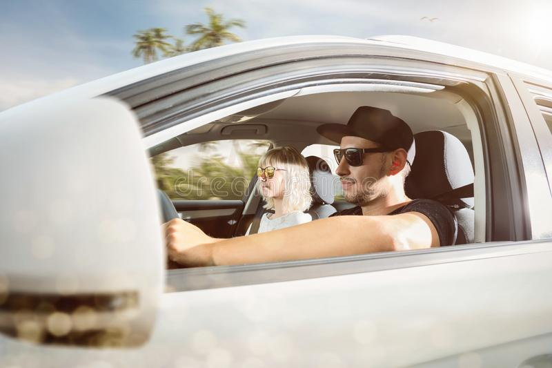 Young couple on summer vacation driving a car in a tropical location stock image