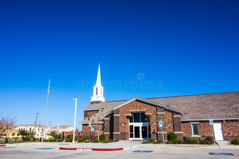 Small Neighborhood Church With White Steeple. Outside Of Small Neighborhood Church With Brick Facade And White Steeple stock images