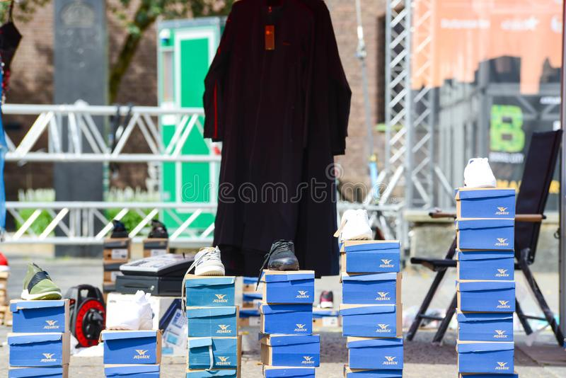 Outside street market Shoe seller. With their shoes in the carton, in the square. copy space dayligtht royalty free stock images