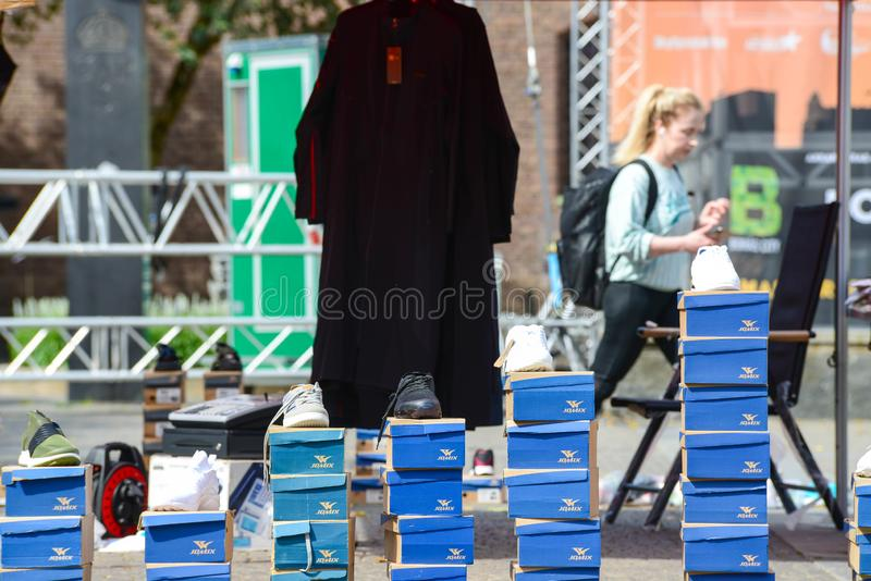 Outside street market Shoe seller. With their shoes in the carton, in the square. copy space dayligtht royalty free stock image
