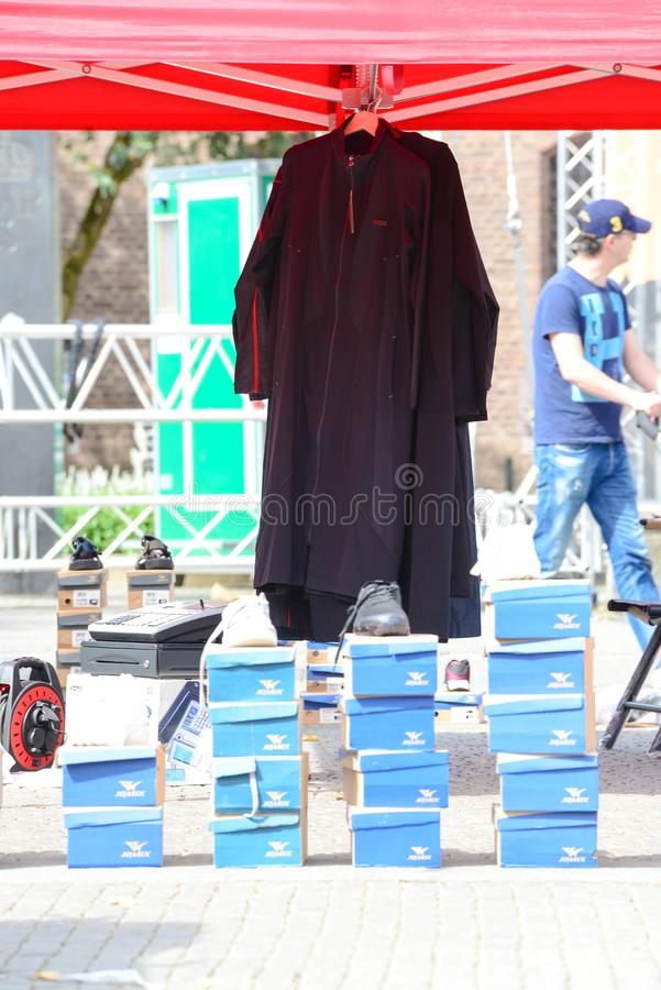 Outside street market Shoe seller. With their shoes in the carton, in the square. copy space dayligtht stock images
