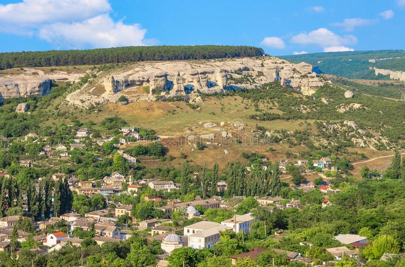 The outskirts of the ancient city of Bakhchisarai runs along the bottom of a deep ravine. The ancient city of Bakhchisarai on the Crimean Peninsula is located royalty free stock images