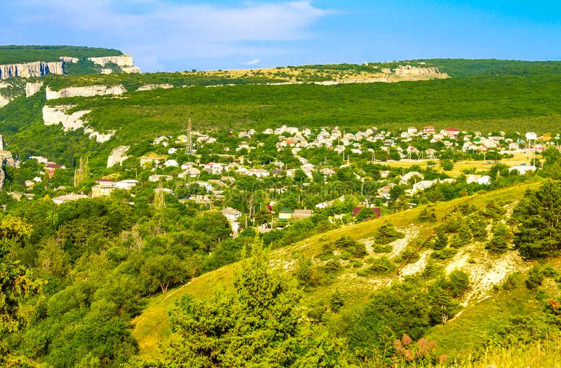 The outskirts of the ancient city of Bakhchisarai runs along the bottom of a deep ravine. The ancient city of Bakhchisarai on the Crimean Peninsula is located stock photo