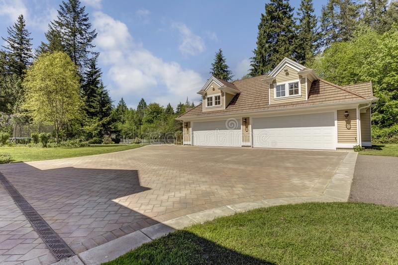 Outstanding country residence with a garage. stock images