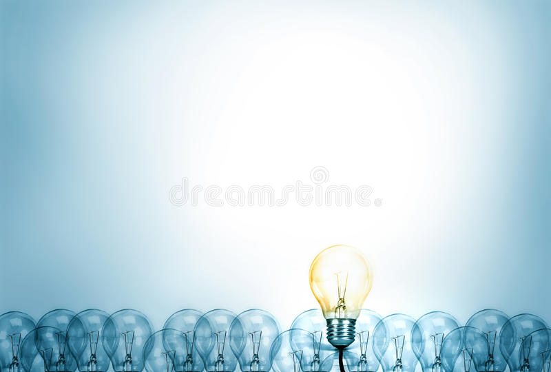 Outstanding creative idea background concept . one Light bulb glowing among a group light bulbs. royalty free stock photos
