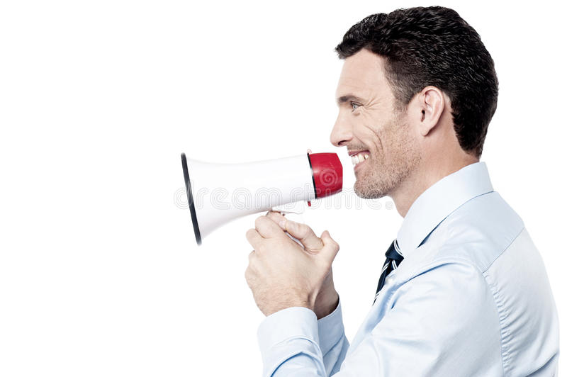 Outstanding news for everyone !. Corporate man making announcement with loudhailer stock image