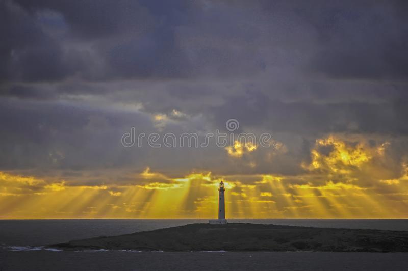 Outstanding Sunset over the Ocean, bright Yellows with Gray and Blues stock photo