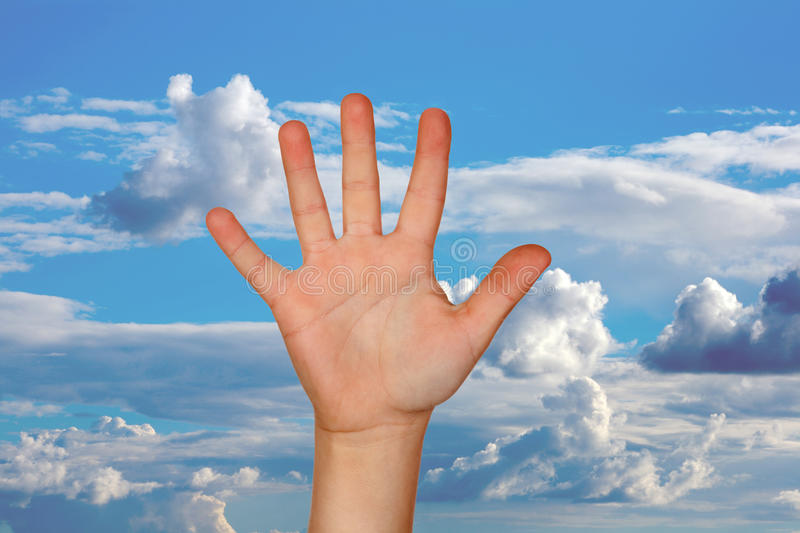 Outstretched hand with a nice blue sky stock photography