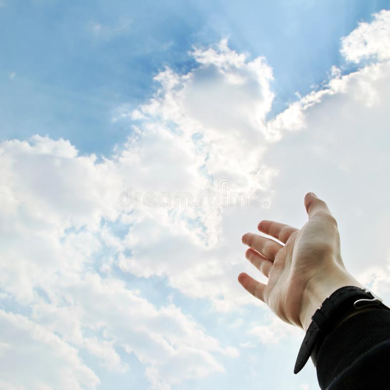 An outstretched hand to the sky stock photos