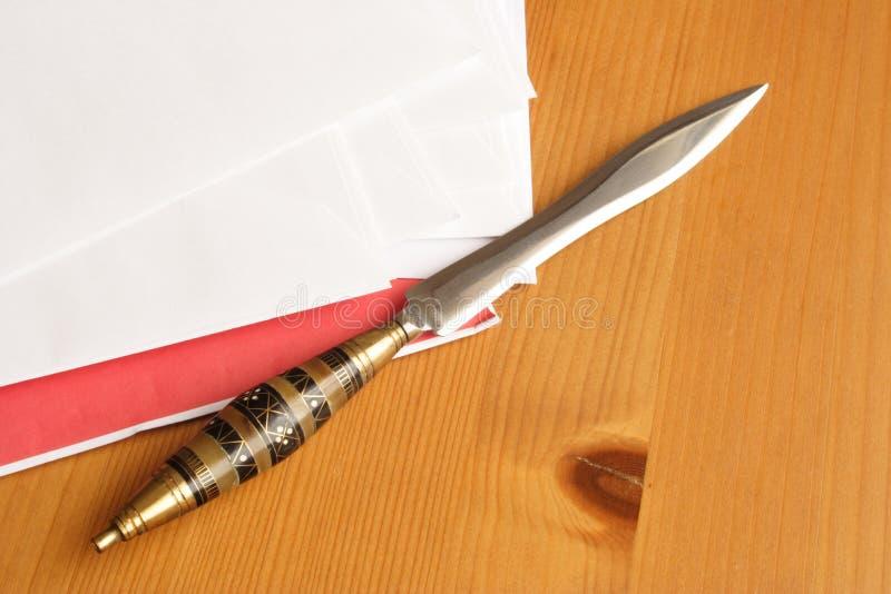 Ouvreur de lettre image stock