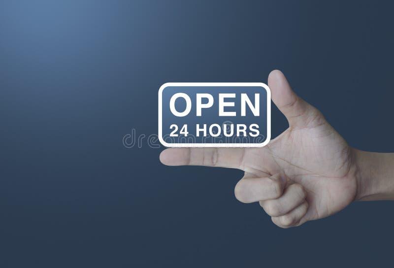Ouvrez 24 heures d'icône sur le doigt photos stock