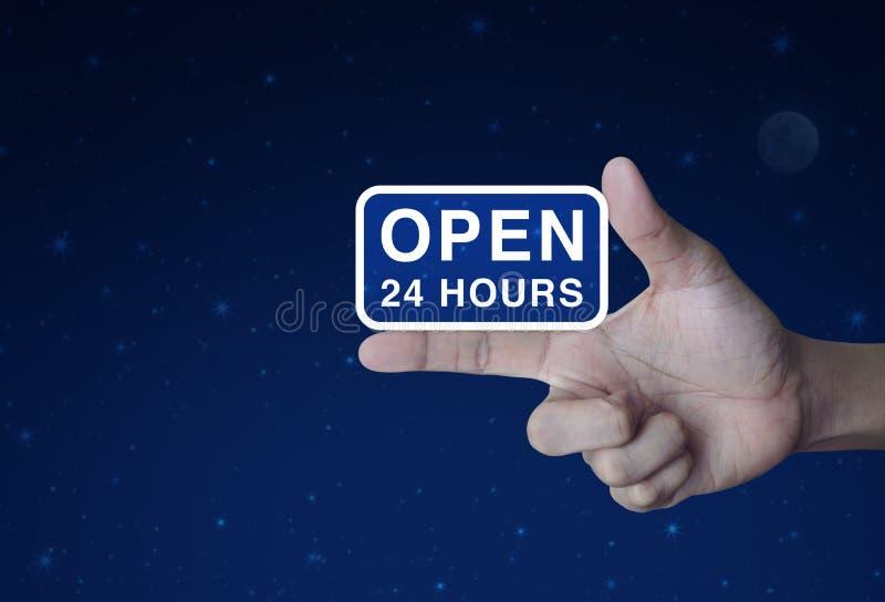 Ouvrez 24 heures d'icône sur le doigt photos libres de droits