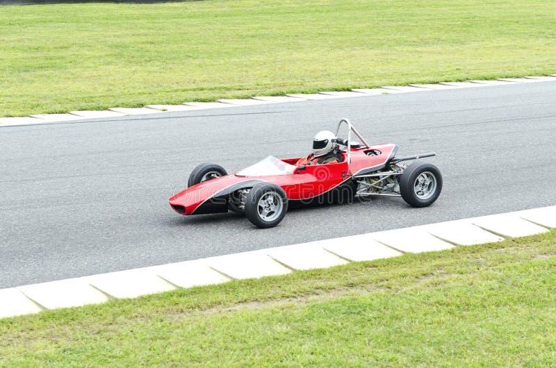 Ouvrez la voiture de course rouge de roue image libre de droits